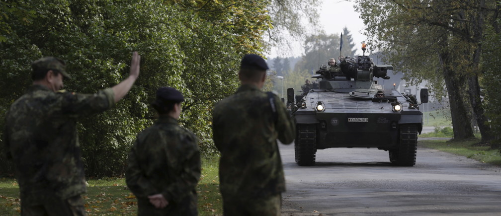 "German army soldiers in their infantry fighting vehicle, the ""Marder"", arrive for the NATO military drill in Adazi, Latvia, October 4, 2015. With signs growing of a thaw between Moscow and Western capitals after the Paris attacks, some of Russia's neighbours fear that European resolve to keep up economic sanctions and military pressure over the Ukraine crisis may be waning. Picture taken October 4, 2015. REUTERS/Ints Kalnins      TPX IMAGES OF THE DAY      - GF20000064888"