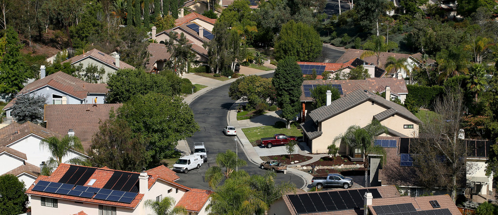 Multiple homes with solar panels are shown in Scripps Ranch, San Diego, California, U.S. October 5, 2016.   Picture taken October 5, 2016.     REUTERS/Mike Blake - S1AEUJDNKAAA