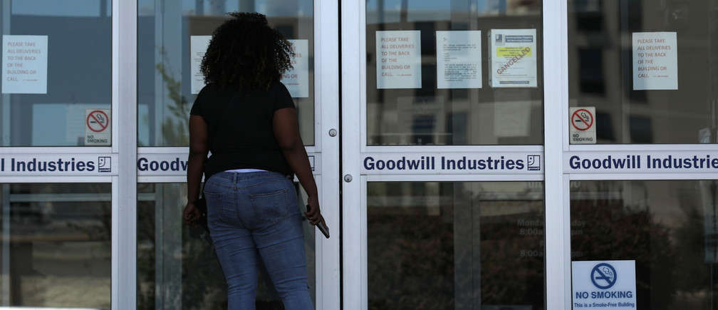 A woman looks for information on the application for unemployment support at the New Orleans Office of Workforce Development, as the spread of coronavirus disease (COVID-19) continues, in New Orleans, Louisiana U.S., April 13, 2020. REUTERS/Carlos Barria - RC224G9LGEBT
