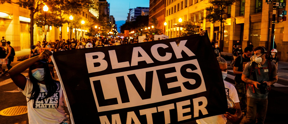 People hold up a Black Lives Matter banner as they march during a demonstration against racial inequality in the aftermath of the death in Minneapolis police custody of George Floyd, in Washington, U.S., June 14, 2020. REUTERS/Erin Scott - RC2D9H9RAS3Z