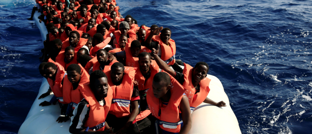 An overcrowded dinghy with migrants from different African countries is followed by members of the German NGO Jugend Rettet as they approach the Iuventa vessel during a rescue operation, off the Libyan coast in the Mediterranean Sea September 21, 2016. REUTERS/Zohra Bensemra TPX IMAGES OF THE DAY