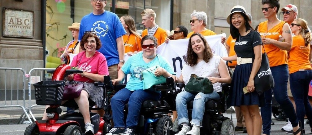 Disability advocate Tiffany Yu (r) with members of the Diversability community