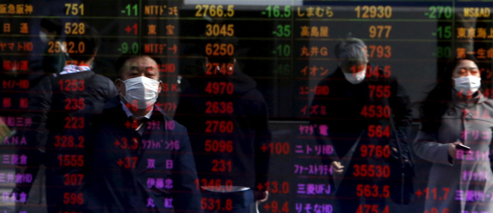 Pedestrians are reflected in an electronic board displaying various stock prices at a brokerage in Tokyo, Japan, February 4, 2016. Asian shares rebounded on Thursday as speculation the U.S. Federal Reserve might opt to not raise interest rates at all this year hammered the dollar and sparked a huge rally in oil prices. REUTERS/Yuya Shino - RTX25D0D
