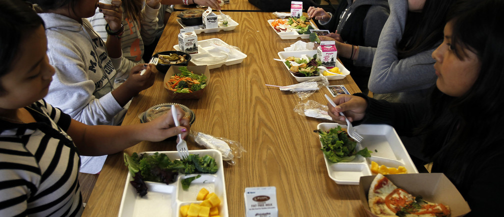 Students sit down to eat a healthy lunch at Marston Middle School in San Diego, California, March 7, 2011.
