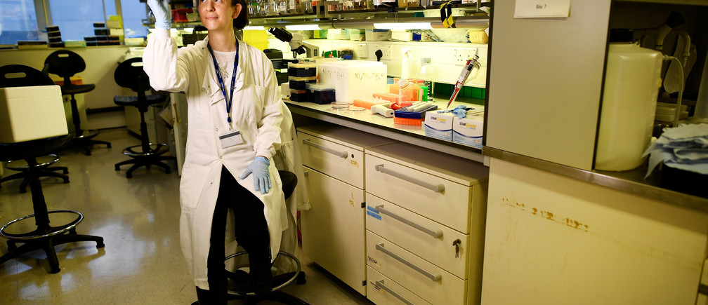 """Dr Catherine Reynolds, 37, a scientific researcher at Imperial College, poses for a picture at her laboratory in London, Britain February 22, 2017. """"Women are very well represented at junior levels in Biological Sciences research. At a senior level it is still true that there are fewer female professors in science, but the gap is slowly closing,"""" Reynolds said. """"More policies that promote flexible working and that support staff in taking career breaks (both men and women) are an essential way in which it is possible for employees, especially those with young families, to realise their full potential in the workplace."""" REUTERS/Dylan Martinez SEARCH """"WOMEN WORK"""" FOR THIS STORY. SEARCH """"WIDER IMAGE"""" FOR ALL STORIES. - RC12DFBECB90"""