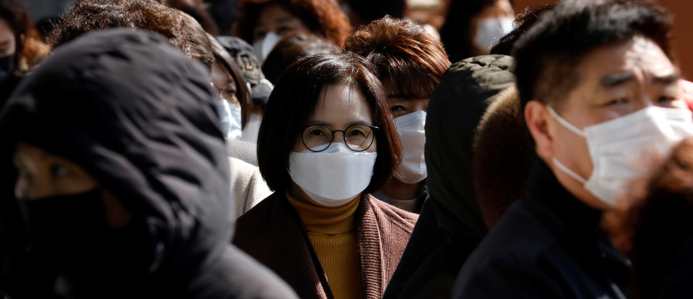 People wearing face masks stand in a line to buy masks at a post office amid the rise in confirmed cases of coronavirus disease (COVID-19) in Daegu, South Korea, March 5, 2020. REUTERS/Kim Kyung-Hoon - RC2KDF90BIH6