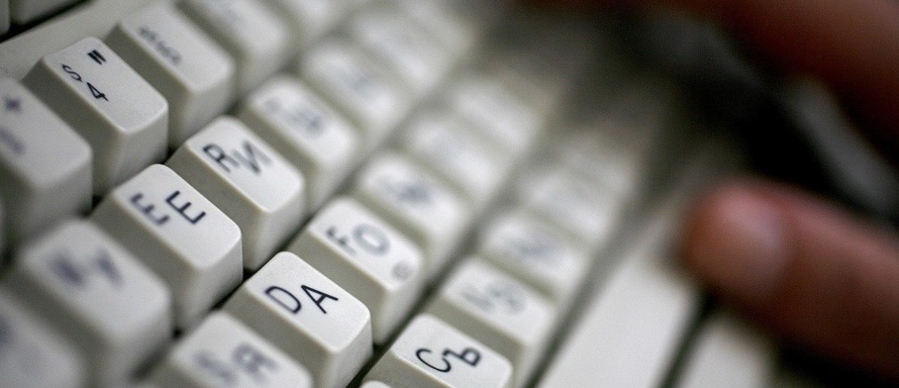 An employee types on a computer keyboard with both Latin and Cyrillic letters in Sofia June 23, 2008. Bulgaria applied on Monday to register an Internet domain name in Cyrillic script as part of efforts to boost national pride amid a growing influence of Engli