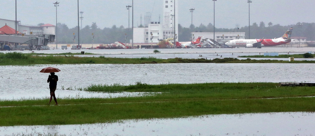 A man walks inside the flooded Cochin international airport after the opening of Idamalayar, Cheruthoni and Mullaperiyar dam shutters following heavy rain, on the outskirts of Kochi, India, August 15, 2018. REUTERS/Sivaram V - RC1BAFD0BD40