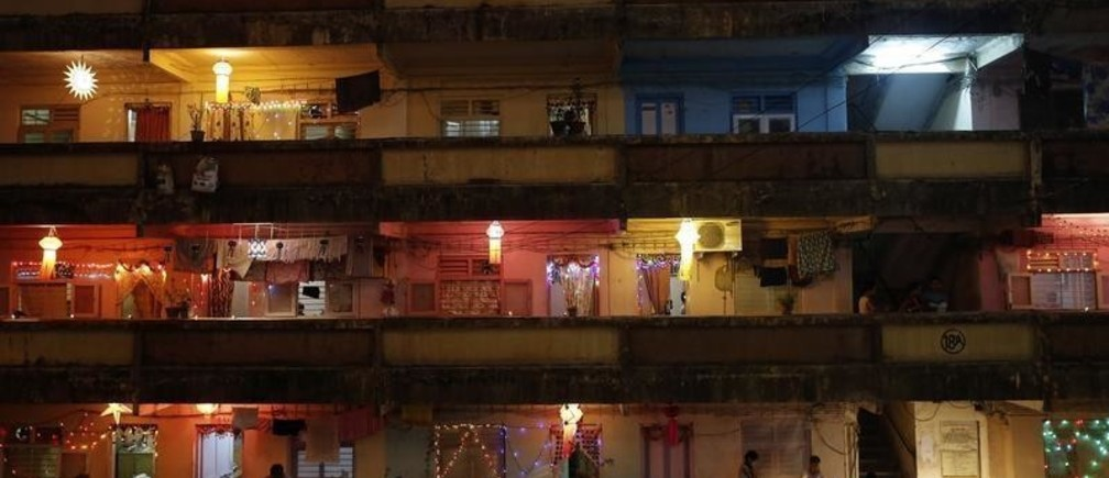 People decorate their houses with lanterns and lights as they celebrate the Hindu festival of Diwali, the annual festival of lights, in Mumbai November 3, 2013. REUTERS/Danish Siddiqui (INDIA - Tags: RELIGION SOCIETY TPX IMAGES OF THE DAY) FOR BEST QUALITY IMAGE ALSO SEE: GF2EA5L07JZ01 - GM1E9B401HY01