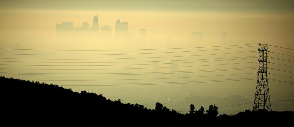 Downtown Los Angeles is seen behind an electricity pylon through the morning marine layer in Los Angeles, California, U.S., August 20, 2019