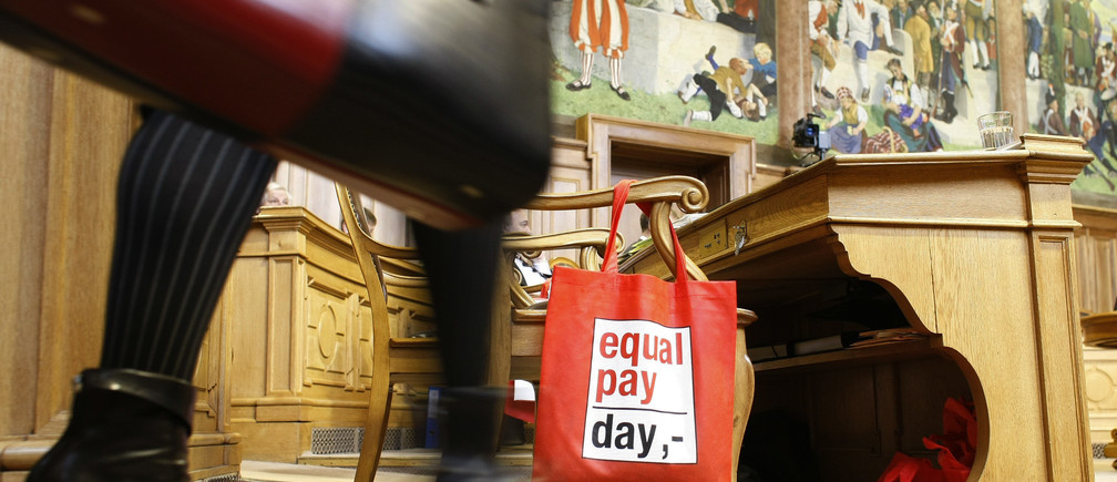 A bag hangs on a chair which reads 'equal pay day,-' to mark the International Womens Day during the spring parliament session in Bern March 10, 2009