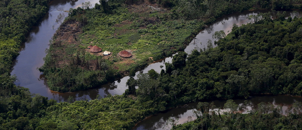 A village of indigenous Yanomami is seen during Brazil's environmental agency operation against illegal gold mining on indigenous land, in the heart of the Amazon rainforest, in Roraima state, Brazil April 18, 2016. REUTERS/Bruno Kelly