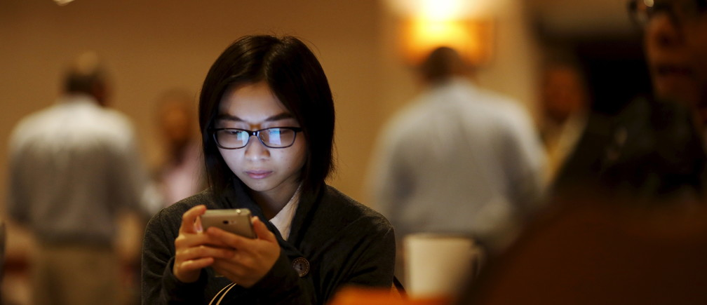People attend a career fair in San Francisco, California July 14, 2015.
