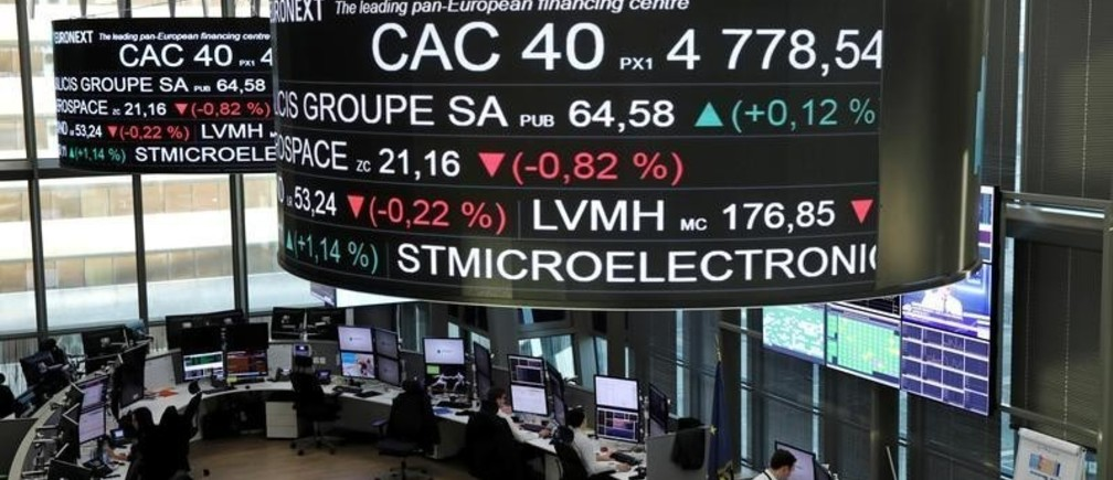 Stock index price for France's CAC 40 and company stock price information are displayed on screens as they hang above the Paris stock exchange, operated by Euronext NV, in La Defense business district in Paris, France, December 14, 2016. REUTERS/Benoit Tessier - RC13E178A910