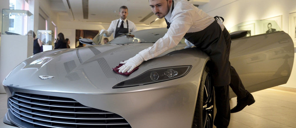 "Employees polish an Aston Martin DB10, one of the series of DB10s designed and engineered by Aston Martin for the James Bond film ""Spectre"", during a media preview of ""Spectre - the Auction"", at Christie's auction house in London February 15, 2016.  REUTERS/Hannah McKay/File Photo        GLOBAL BUSINESS WEEK AHEAD PACKAGE - SEARCH 'BUSINESS WEEK AHEAD MAY 30'  FOR ALL IMAGES - S1BETGXRGIAB"