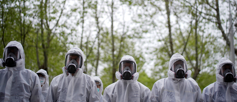Volunteers from the Blue Sky Rescue team  wearing protective suits is seen at the Qintai Grand Theatre in Wuhan, Hubei province, the epicentre of China's coronavirus disease (COVID-19) outbreak, April 2, 2020. Picture taken April 2, 2020. REUTERS/Aly Song - RC2QWF9D4N84