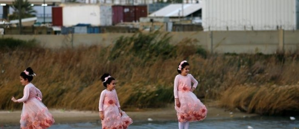 Ultra-Orthodox Jewish girls pose for a photographer near the beach in the southern city of Ashdod December 13, 2016. REUTERS/Amir Cohen