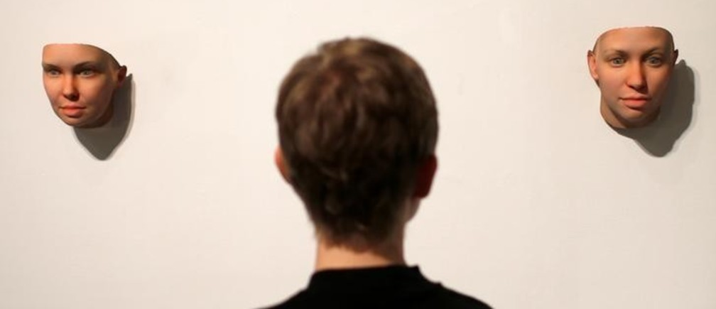 """Artist Heather Dewey-Hagborg looks at 3-D printed masks she created from DNA extracted from cheek swabs and hair clippings she received from formerly imprisoned U.S. Army Private Chelsea Manning while she was in jail, ahead of the August 2, 2017 opening of  """"A Becoming Resemblance"""", an exhibition at the Fridman gallery in New York City, July 7, 2017.  REUTERS/Mike Segar"""