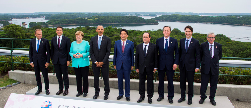 European Council President Donald Tusk, Italian Prime Minister Matteo Renzi, German Chancellor Angela Merkel, US President Barack Obama, Japanese Prime Minister Shinzo Abe, French President Francois Hollande, British Prime Minister David Cameron, Canadian Prime Minister Justin Trudeau and European Commission President Jean-Claude Juncker pose for the family photo during the first day of the Group of Seven (G7) summit meetings in Ise Shima, Japan, May 26, 2016.