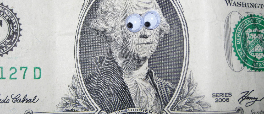 A dollar bill with cartoon eyes