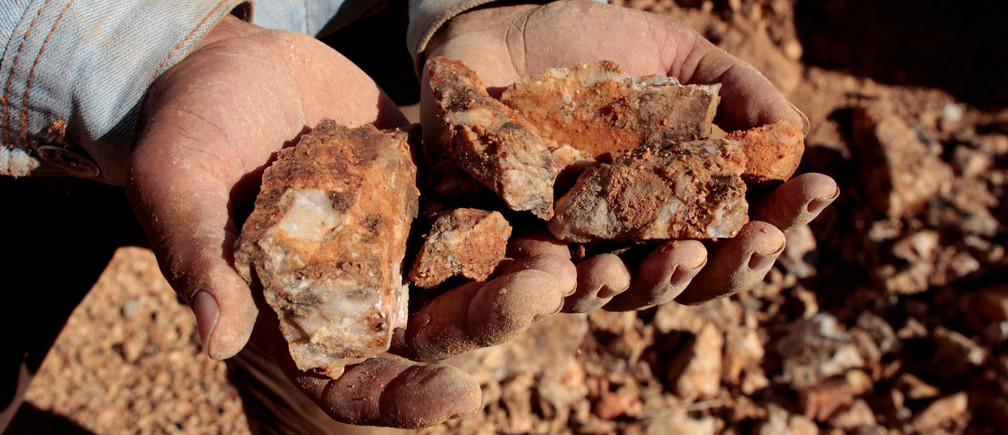 An artisanal miner holds rocks containing gold ore in a mine in Villanueva, Nicaragua