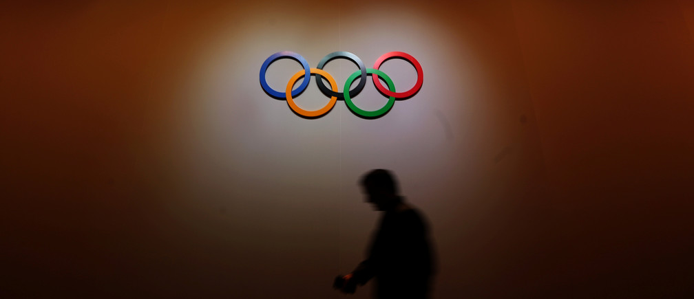 A man walks past the Olympic Rings as he walks out of the 133rd International Olympic Committee (IOC) session in Buenos Aires, Argentina October 8, 2018. REUTERS/Marcos Brindicci - RC1C7F042AF0
