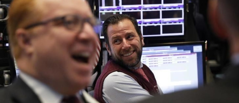 Traders laugh as they work on the floor of the New York Stock Exchange (NYSE) in New York, U.S., January 4, 2017.  REUTERS/Lucas Jackson
