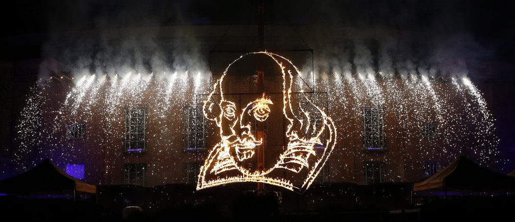 A flaming depiction of William Shakespeare is seen during a firework display at the Royal Shakespeare Company marking the 450th anniversary of Shakespeare's birth in Stratford-upon-Avon.