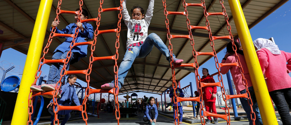 Syrian refugee children play at al-Zaatari refugee camp, Jordan.
