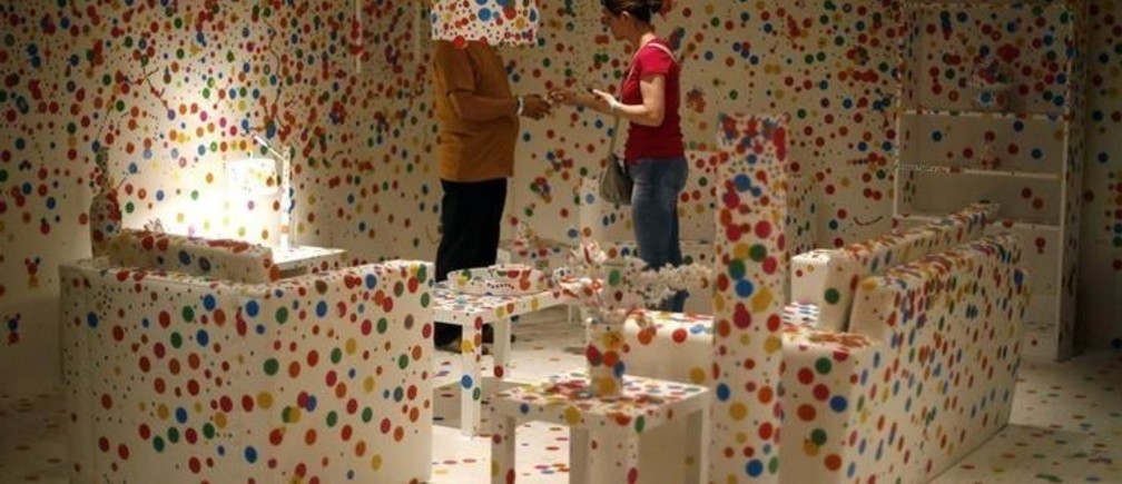 "A couple visits an artwork which is part of the ""Infinity Obsession"" exhibition by Japanese artist Yayoi Kusama in Santiago City March 9, 2015. The installation is part of Kusama's first exhibition in Chile which will be open until June 7, 2015, according to organisers. REUTERS/Ivan Alvarado (CHILE - Tags: SOCIETY)"