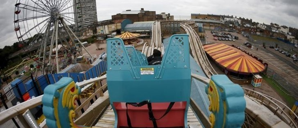 Locals ride the Scenic Railway rollercoaster during a media preview at Dreamland in Margate, Britain, October 15, 2015. Britain's oldest rollercoaster Scenic Railway reopens for public on Friday. REUTERS/Stefan Wermuth