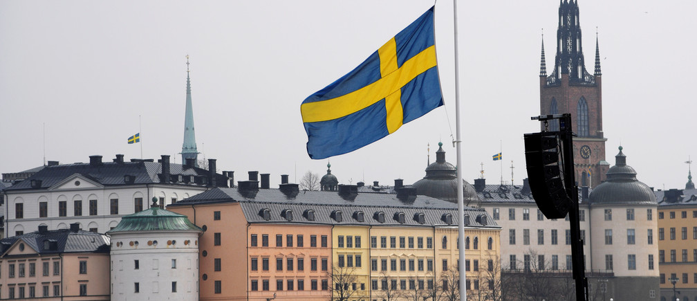 Flag at half mast at the official ceremony at Stockholm City Hall with one minute of silence at noon to remember the victims of Friday's terror attack on Drottninggatan, Stockholm, Monday,  April 10, 2017. TT NEWS AGENCY/Anders Wiklund via REUTERS ATTENTION EDITORS - THIS IMAGE WAS PROVIDED BY A THIRD PARTY. FOR EDITORIAL USE ONLY. NOT FOR SALE FOR MARKETING OR ADVERTISING CAMPAIGNS. SWEDEN OUT. NO COMMERCIAL OR EDITORIAL SALES IN SWEDEN. NO COMMERCIAL SALES. - RC14654E7730