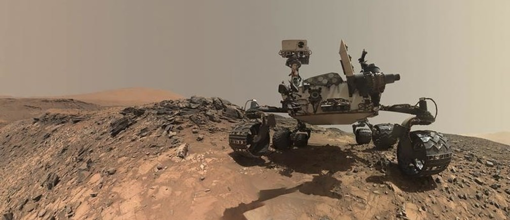 NASA's Curiosity Mars rover is seen at the site from which it reached down to drill into a rock target called 'Buckskin' on lower Mount Sharp in this low-angle self-portrait taken August 5, 2015 and released August 19, 2015. The selfie combines several component images taken by Curiosity's Mars Hand Lens Imager (MAHLI) during the 1,065th Martian day, or sol, of the rover's work on Mars, according to a NASA news release.  REUTERS/NASA/JPL-Caltech/MSSS/Handout  THIS IMAGE HAS BEEN SUPPLIED BY A THIRD PARTY. IT IS DISTRIBUTED, EXACTLY AS RECEIVED BY REUTERS, AS A SERVICE TO CLIENTS. FOR EDITORIAL USE ONLY. NOT FOR SALE FOR MARKETING OR ADVERTISING CAMPAIGNS - TM3EB8J17BD01