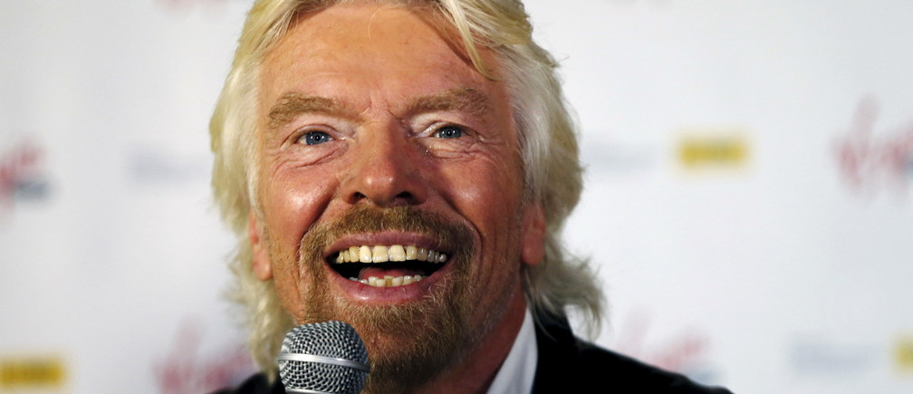 Virgin Group founder Richard Branson speaks at a press event in Sydney, September 9, 2015. Branson announced that on September 10 in Australia all phone calls from his Virgin Mobile phone company will be free, a 'call-to-arms' for Australians to talk to others in as more personal means than emails and social media.   REUTERS/Jason Reed     - RTS7GI