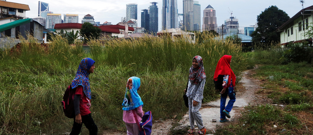 Girls make their way home after school in Kuala Lumpur, Malaysia