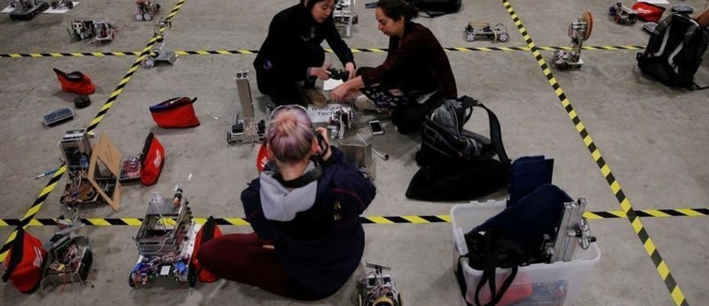"""Undergraduate students from MIT's Department of Mechanical Engineering prepare to compete in the annual 2.007, """"Star Wars"""" themed, robot competition at Massachusetts Institute of Technology in Cambridge, Massachusetts, U.S., May 11, 2017."""