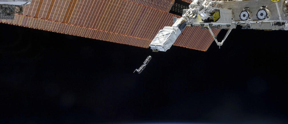 The Small Satellite Orbital Deployer (SSOD), in the grasp of the Kibo laboratory robotic arm, is photographed by an Expedition 38 crew member on the International Space Station as it deploys a set of NanoRacks CubeSats in this February 11, 2014 NASA photo. The CubeSats program contains a variety of experiments such as Earth observations and advanced electronics testing. Station solar array panels, Earth's horizon and the blackness of space provide the backdrop for the scene.  REUTERS/NASA/Handout (UNITED STATES - Tags: SCIENCE TECHNOLOGY) FOR EDITORIAL USE ONLY. NOT FOR SALE FOR MARKETING OR ADVERTISING CAMPAIGNS. THIS IMAGE HAS BEEN SUPPLIED BY A THIRD PARTY. IT IS DISTRIBUTED, EXACTLY AS RECEIVED BY REUTERS, AS A SERVICE TO CLIENTS - GM1EA2D07UW01