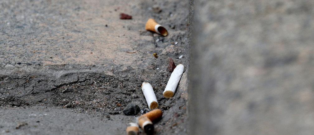 Cigarette butts litter the street in Rochefort, France, June 14, 2018. The French government wants to end the bane of discarded cigarette butts and will impose new regulations unless tobacco companies come up with proposals to reduce their number. REUTERS/Regis Duvignau - RC17EF1C9680