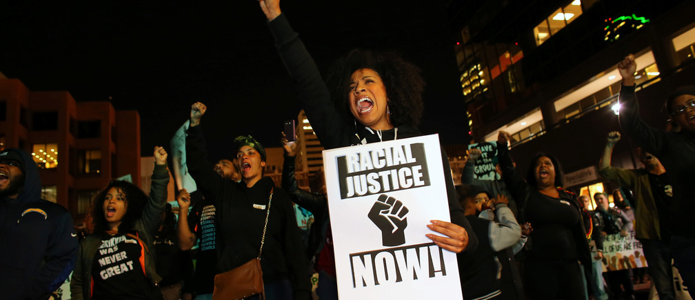 """Demonstrators in the """"Fight for $15"""" wage protest are joined by social justice and Black Lives Matter activists at a rally in downtown San Diego, California, U.S., November 29, 2016. REUTERS/Mike Blake - RC1BE23C5B50"""
