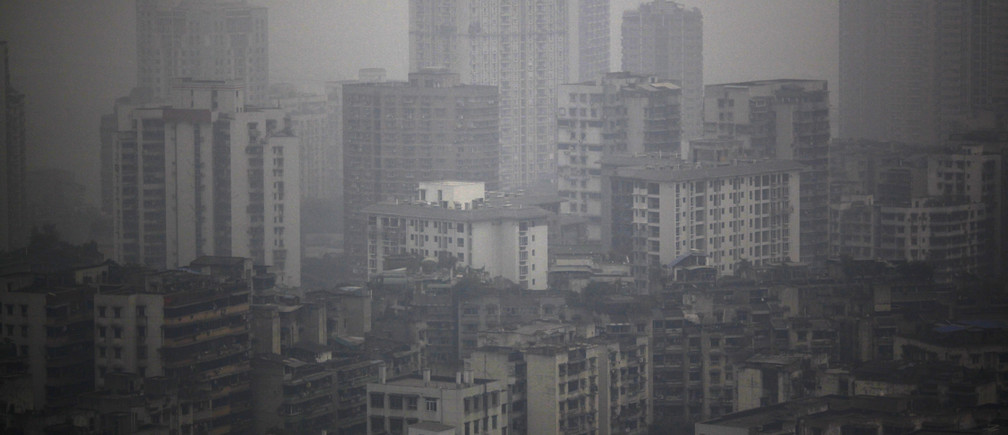 Buildings are seen on a hazy day in downtown Chongqing January 30, 2013.  REUTERS/ Carlos Barria  (CHINA - Tags: ENVIRONMENT CITYSCAPE) - GM1E91U0UZU01