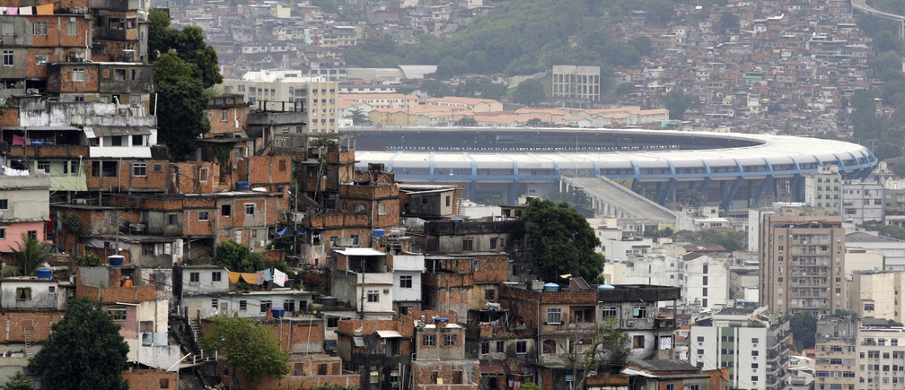 The Maracana stadium is seen between Turano slum (L) and Mangueira slum in Rio de Janeiro May 14, 2010.