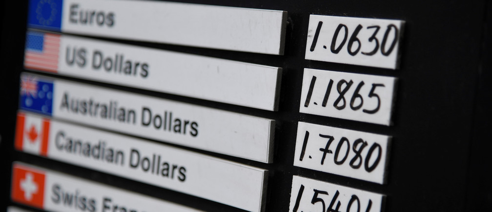 A board displaying buying and selling rates is seen outside of a currency exchange outlet in London, Britain, July 31, 2019. REUTERS/Toby Melville - RC1EA7E98F20