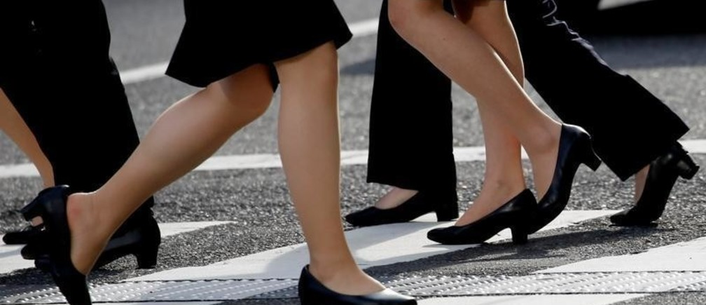 Women in high heels walk at a business district in Tokyo, Japan, June 4, 2019.  REUTERS/Kim Kyung-Hoon - RC19E3187290