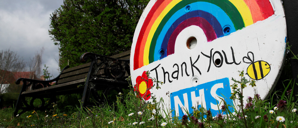 A rainbow sign thanking the NHS is seen in Hertford as the spread of the coronavirus disease (COVID-19) continues, Hertford, Britain, April 3, 2020. REUTERS/Andrew Couldridge - RC21XF9J9FCK