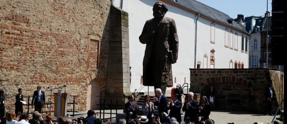 The 4.4 metres (14 feet) high bronze statue of Karl Marx, created by Chinese artist Wu Weishan and donated by China to mark the 200th birth anniversary of the German philosopher, is seen in his hometown Trier, Germany May 5, 2018. REUTERS/Wolfgang Rattay