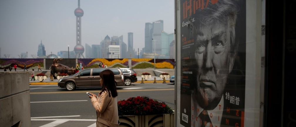 A Chinese magazine poster showing U.S. President Donald Trump is displayed at a newsstand in Shanghai