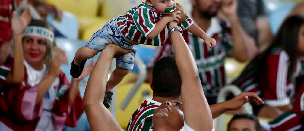 Soccer Football - Brasileiro Championship - Fluminense v Sport Recife - Maracana Stadium, Rio de Janeiro, Brazil - November 11, 2018  Fluminense fan holds a baby  REUTERS/Pilar Olivares - RC15AC851160