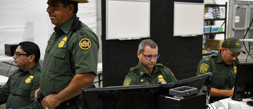 U.S. Border Patrol agents sit at computers during a tour of U.S. Customs and Border Protection (CBP) temporary facilities in Donna, Texas, U.S. May 2, 2019.