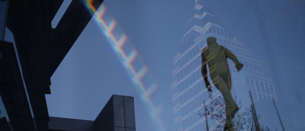 A building and a sculpture are reflected on glass in a wealthy neighborhood, during a general quarantine imposed due to a surge of fresh coronavirus disease (COVID-19) cases, in Santiago, Chile May 18, 2020. REUTERS/Ivan Alvarado - RC2CRG97YIIJ