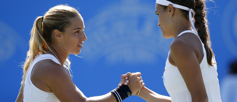 Britain Tennis - Aegon International - Devonshire Park, Eastbourne - 24/6/16Slovakia's Dominika Cibulkova shakes hands with Puerto Rico's Monica Puig (R) after victory in the semi finalAction Images via Reuters / Peter CziborraLivepicEDITORIAL USE ONLY. - RTX2I11A
